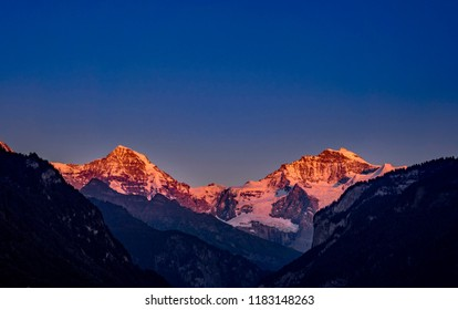 Alpenglow, the mountains Mönch and Jungfrau in the Bernese Alps, Bernese Oberland, Interlaken, Canton Bern, Switzerland, Europe