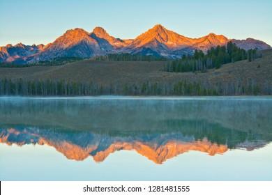 Alpenglow, sunrise, reflections, Little Redfish Lake, Sawtooth National Forest, Stanley, Idaho