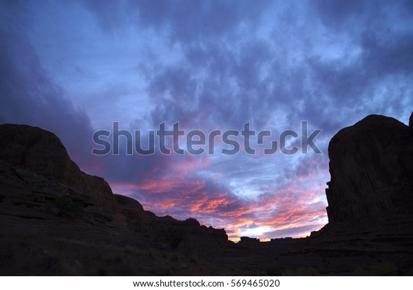 Alpenglow Sunset in Courthouse Wash at Arches National Park near Moab, Utah