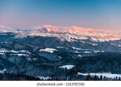 Alpenglow in winter on Eiger Mönch and Jungfrau in the Bernese Alps