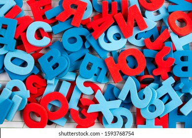Alphabet background of colorful letters and numbers. Concept back to school.