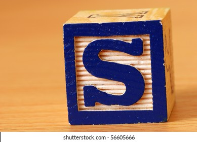 Alphabet block with a blue letter S
