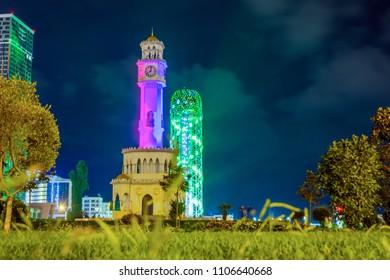 Alphabet and clock tower at night time, Batumi, Georgia