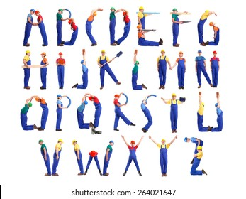 Alphabet formed from young people wearing industrial uniforms and helmets posing with various tools and accessories