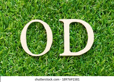 Alphabet letter in word OD (Abbreviation of overdraft) on green grass background