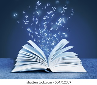 alphabet letters around open book