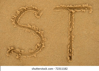 Alphabet letters handwritten in sand ideal for font, nature or conceptual designs