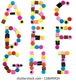 Alphabet letters made from colorful candy sweets and liquorice