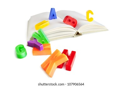 alphabet letters on a book isolated on white