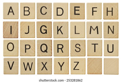 Alphabet letters on wooden letter pieces, isolated on white.