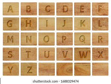 Alphabet letters on wooden pieces, isolated on a white background.