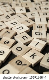 Alphabet letters on wooden scrabble pieces, close up
