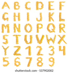 Alphabet made of macaroni letters isolated on white background