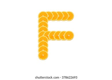 Alphabet, Made of sliced citrus, orange fruit Isolated on white background.