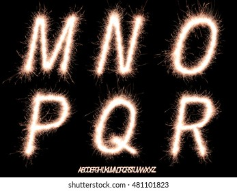 Alphabet M,N,O,P,Q,R made of sparklers font isolated on black background