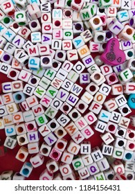 alphabet on white tiny cubes to create breslate with name