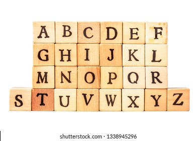 the alphabet on wooden cubes isolated on white