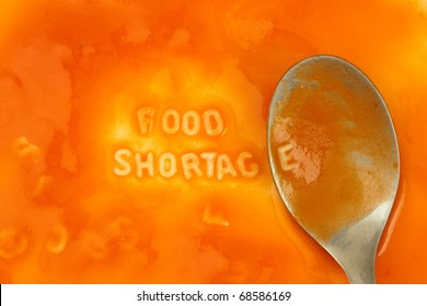 Alphabet pasta forming the words 'food shortage' over a layer of tomato soup