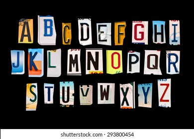 Alphabet set created with broken pieces of vintage car license plates