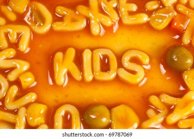Alphabet shaped pasta forming the word KIDS in tomato sauce
