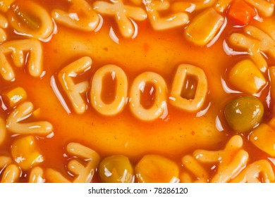 Alphabet shaped pasta forming the word FOOD in tomato sauce