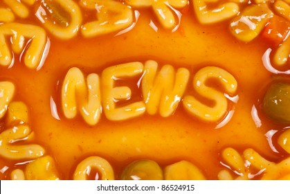 Alphabet shaped pasta forming the word NEWS in tomato sauce
