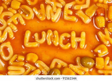 Alphabet shaped pasta forming the word LUNCH in tomato sauce