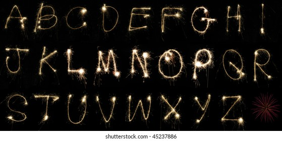 The alphabet spelled out by hand using sparklers at night on long exposure. Can be cropped to spell out any word or message.