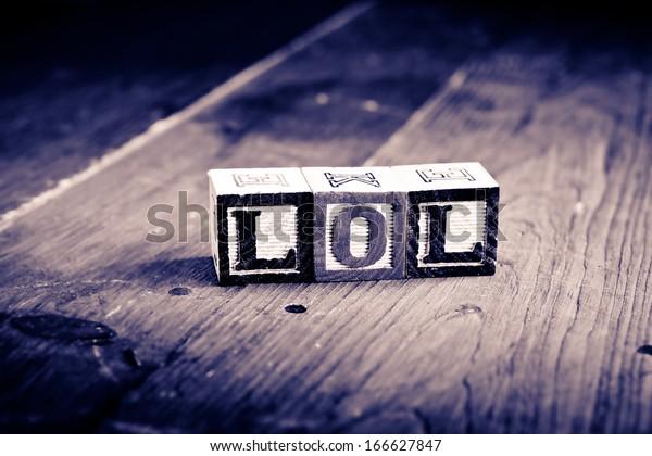 alphabet wood blocks forming the word lol.  Vintage process.