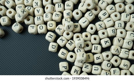 alphabet wood cube on black background  for  education concept