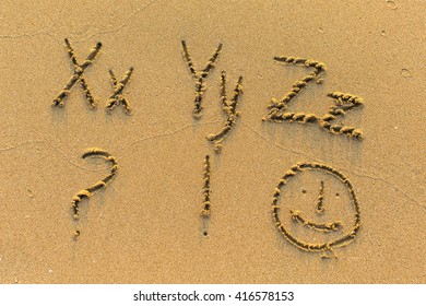 Alphabet written by hand on sandy beach (letters from X to Z)