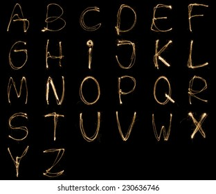 Alphabet written with a sparkler isolated on black background