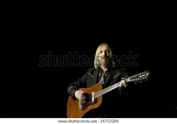 ALPHARETTA GA - JULY 9: Tom Petty and the Heartbreakers perform at the Verizon Ampitheatre at Encore Park on July 9, 2008 in Alpharetta, Georgia.