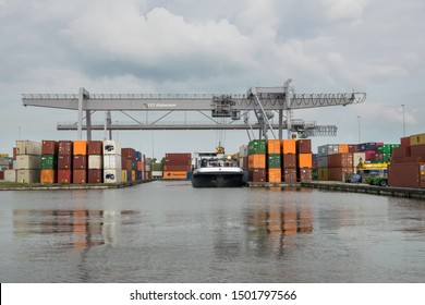 """Alphen aan den Rijn, Netherlands - September 10th 2019: Container terminal """"Alpherium"""" near the crosspoint of the rivers Gouwe and Oude Rijn."""