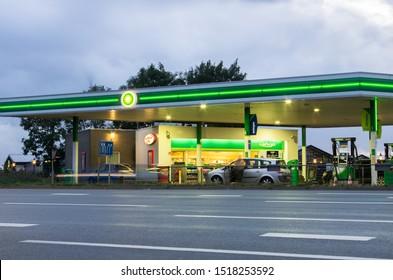 Alphen aan den Rijn, Netherlands - 26 SEPTEMBER 2019:BP gas station at Leidse Schouw 10, Alphen ad Rijn at night with light stripes and motion blur.