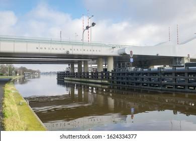 Alphen aan den Rijn, Netherlands - January 23rd 2020: Koningin Máximabrug (Queen Máxima Bridge) over the river Rhine in the town of Alphen aan den Rijn, Holland.