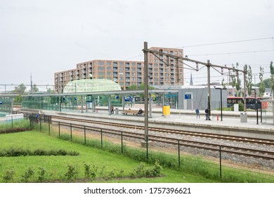 Alphen aan den Rijn, Netherlands - June 2020: Railway station of Alphen aan den Rijn, Holland. The green barred storage is called 'The Apple' and here cyclists can store their bicycles.