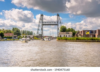 Alphen aan den Rijn, The Netherlands - July 26 2020: bridge is open to allow several boats to pass