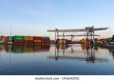 ALPHEN AAN DEN RIJN, Netherlands - APRIL 13, 2021: large inland container terminal Alpherium harbor. Cargo transport.