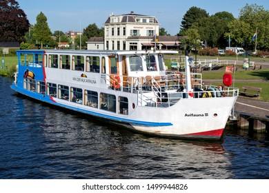 ALPHEN AN DEN RIJN, THE NETHERLANDS - JUNE 30, 2019: Excursion boat AVIVAUNA III of Van der Valk. Van der Valk is the largest Dutch hospitality chain and also operates the Avifauna Bird Park.