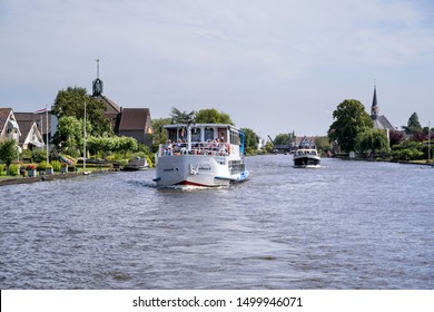 ALPHEN AN DEN RIJN, THE NETHERLANDS - JUNE 30, 2019: Excursion boat AVIVAUNA III on canal cruise. Van der Valk is the largest Dutch hospitality chain and also operates the Avifauna Bird Park.