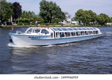 ALPHEN AN DEN RIJN, THE NETHERLANDS - JUNE 30, 2019: Excursion boat AVIVAUNA II on canal cruise. Van der Valk is the largest Dutch hospitality chain and also operates the Avifauna Bird Park.