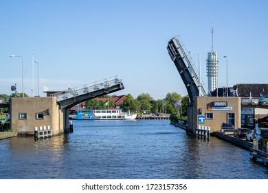 ALPHEN AN DEN RIJN, THE NETHERLANDS - JUNE 30, 2019: s-Molenaarsbrug bascule bridge over Heimanswetering waterway