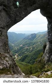 Alpi Apuane, Forte dei Marmi, Lucca, Tuscany, Italy.  Monte Forato, arch pass. In the background the sea of Versilia.