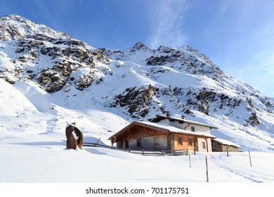 Alpine chalet house and mountain panorama with snow in winter in Stubai Alps, Austria