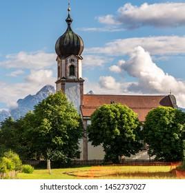 Alpine church in the village Krün in Bavaria (Germany)