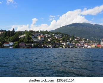 Alpine cityscape of european city of Ascona and panorama of Lake Maggiore at riviera landscapes in Ticino canton in SWITZERLAND with cloudy blue sky in 2017 warm sunny summer day on July.