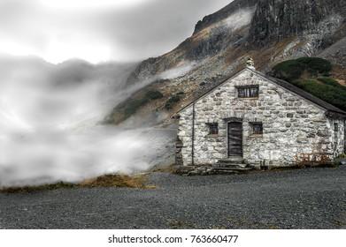 alpine hut clouds