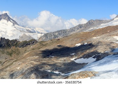 Alpine hut Defreggerhaus at Grossvenediger glacier and mountain panorama in the Hohe Tauern Alps, Austria