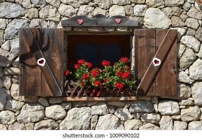 alpine hut; flower window; Dolomite Alps; South Tyrol; Italy;